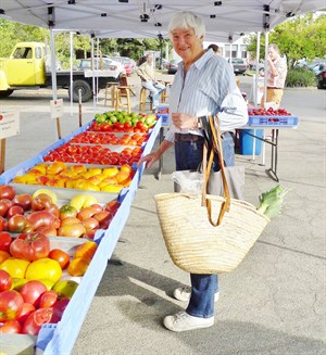 Farmers' Market in Healdsburg, Sonoma County. Mary Hafner shopping for her week's meals.