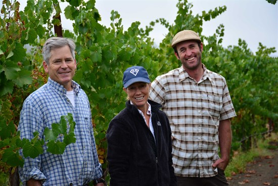 Parke and Sarah Hafner along with Vineyard Manager, David Huebel, taste the Chardonnay fruit and discuss when to the Harvest will begin.