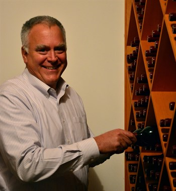 Scott Hafner organizes his wine cellar for the holidays.