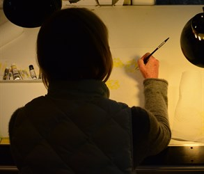 Sarah Hafner works on a watercolor.